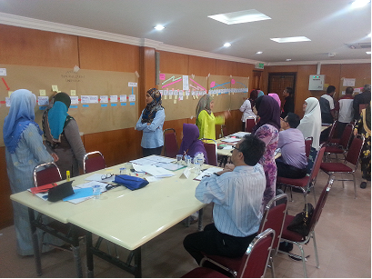 The participants were talking about mapping processes selected during the workshop.
